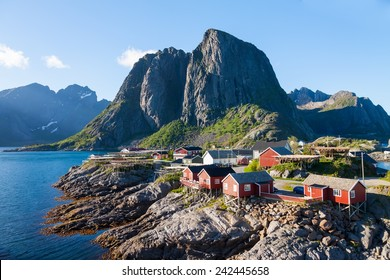 Scenic town of Reine by the fjord on Lofoten islands in Norway on sunny summer day