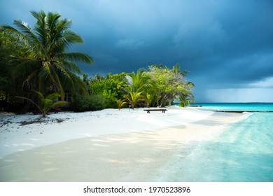 Scenic tropical beach in Maldivies with coming storm