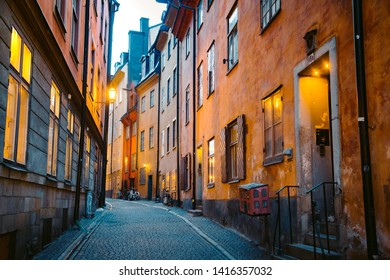 Scenic twilight view of tradtional houses in beautiful alleyway in Stockholm's historic Gamla Stan (Old Town) illuminated during blue hour at dusk, central Stockholm, Sweden