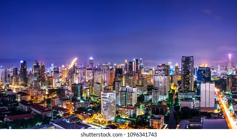 scenic of urban metropolis night cityscape on twilight skyline and speed light tail of car