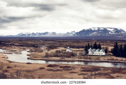Scenic valley and a village in Thingvellir National Park - famous area in Iceland
