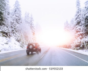 scenic veiw of empty road with snow covered landscape while snowing in winter season.