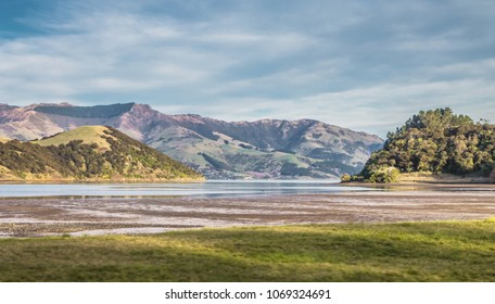 Scenic View of Akaroa Harbour at low tide. Akaroa Harbour is part of the  Banks Peninsula in the Canterbury Region of New Zealand.