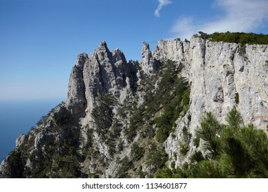 Scenic view of amazing Mount Ai-Petri against blue sky and the Black sea background. Mountains, hiking, adventure, traveling, tourist attraction, landscape and altitude concept. Crimea, Russia.