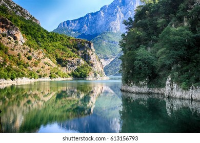 Scenic view with amazing mountains at Koman Lake on Drin River in Albania