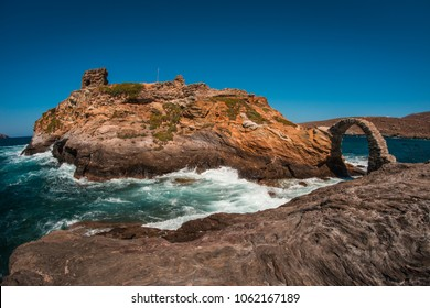 Scenic view to ancient bridge to small island near the town of Andros, Andros, Greece