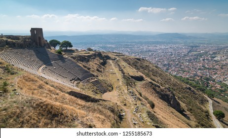 The scenic view of an ancient city and theater of The Acropolis of Pergamum (Pergamon) on the mountain viewpoint. Bergama, Izmir, Turkey.