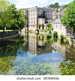 Scenic View of an Apartment Building Reflected in the River of a Picturesque Town - Namely the Landmark Bradford on Avon in Wiltshire England
