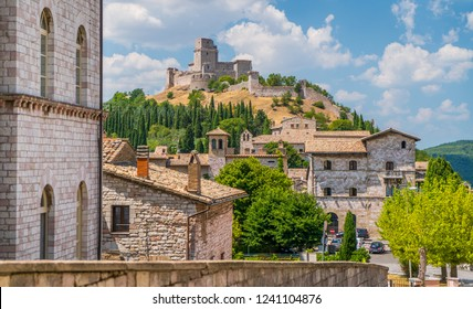 Scenic view in Assisi with the Rocca Maggiore and olive trees. Umbria, Italy.