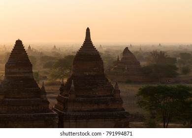 Scenic view of Bagan Plain with many pagodas and temples in Bagan, Myanmar (Burma) at sunrise.