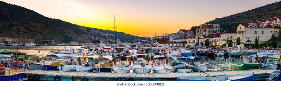 Scenic view of Balaklava. Many moored yachts and boats. Sunset, Sevastopol, Crimea