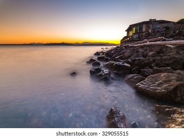scenic view of the beach in blue hour from Alki Beach, West Seattle, Washington, USA.