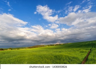 Scenic view of beautiful country landscape. Clouds passing above rural fields in South Moravia, Czech Republic.