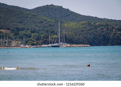 Scenic view of beautiful sea with marina and hills on background.