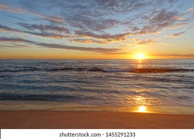 Scenic View of a Beautiful Sunset Sky on A Seaside Beach