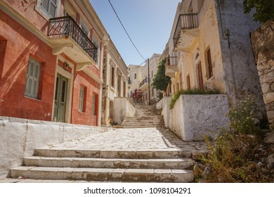 Scenic view of beautiful traditional houses and old architectural colorful buildings in Symi island near Rhodes, Greece