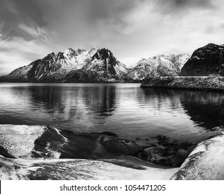 Scenic view of beautiful winter lake with snowy mountains at Lofoten Islands in Northern Norway. Blsck and white