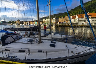 Scenic view of Bergen harbor with boats moored and Bryggen Hanseatic Wharf in the background. Bergen, Norway, August 2018
