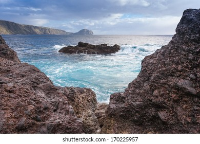 Scenic view at blue atlantic ocean through cliffs on Faial island. Azores islands.