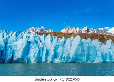 Scenic view of blue ice of Glacier Grey, The ripple of Lke Grey and the beautiful snow mountain at Torres del Paine National Park in Chile