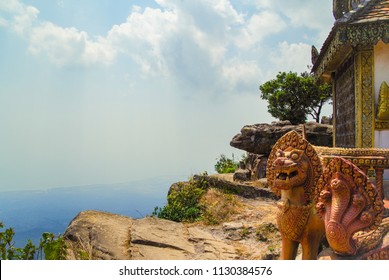 Scenic view from Bokor mountain on coast of gulf of Siam - a coastal line of Kampot. Lion and naga at an entrance to pagoda. Cambodia, Preah Monivong Bokor National Park