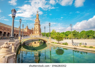Scenic view with bridge and reflection in water of famous Spanish Square (Plaza de Espana). Seville, Andalusia, Spain
