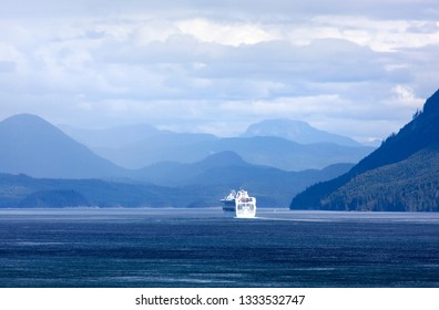 The scenic view of British Columbia landscape with a cruise ship in a background (Canada).