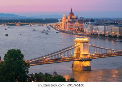 Scenic view of Budapest citylights from Castle Hill with Danube river, Chain Bridge and Parliament Building at twilight, Budapest, Hungary