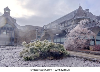 Scenic view of building and bushes covered by ice and snow in Niagara Falls in Canada. Beautiful depressive winter look of house and garden on Niagara river