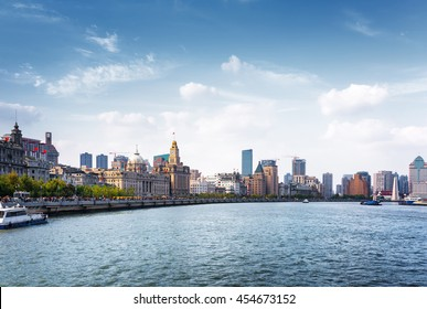 Scenic view of the Bund (Waitan) in Shanghai, China. Waterfront of the Huangpu River is a popular tourist destination of Asia. The Shanghai Custom House building is visible in center of picture.