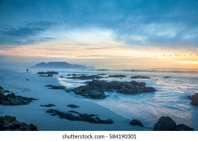 scenic view of Cape Town table mountain at sunset from bloubergstrand south africa