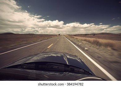 scenic view from car on long lonely old asphalt road Route 66 and blue sky, USA, Vintage filtered style