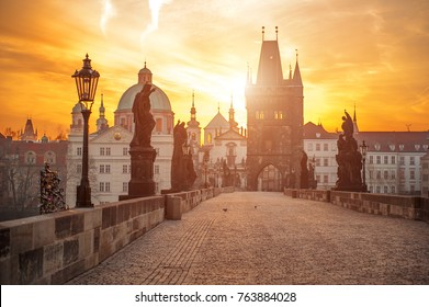 Scenic view of Charles Bridge (Karluv Most) and Lesser Town Tower Prague symbol at sunrise, Czech Republic, Europe