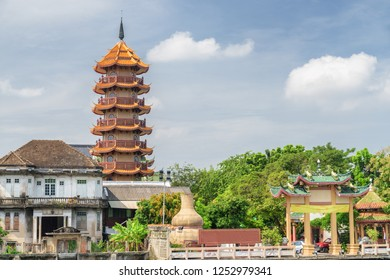 Scenic view of Chee Chin Khor Temple in Bangkok, Thailand. Chinese-style pagoda at the Buddhist temple is visible on blue sky background. Bangkok is a popular tourist destination of Asia.