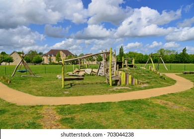 Scenic View of a Children's Playground and Pathway through a London Public Park