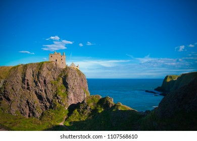 Scenic view of cliffs with rocks near the ocean and the blue sea