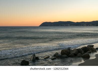 Scenic view of the coast of the Ligurian Sea with Capo Mele cape at sunset, Alassio, Liguria, Italy