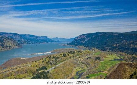 Scenic view of Columbia River Gorge receding under blue sky and cloudscape, Oregon, U.S.A.