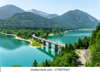 Scenic view of country road and lake Sylvenstein Speicher, Bavaria, Germany