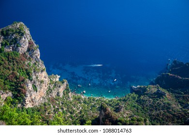 Scenic view of the dazzling Mediterranean blue waters from the dramatic clifftop mountain coastline of the island of Capri, Italy