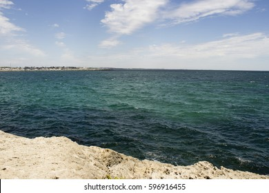 Scenic view of  the deep Indian Ocean  from the rocky   limestone   wall of the South Mole , Port of Fremantle, Western Australia on  a fine cloudy  afternoon in late spring .