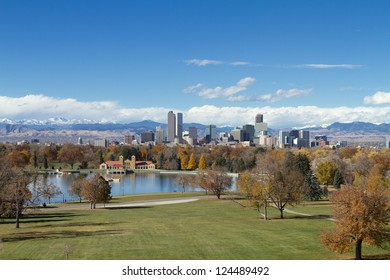 Scenic view of Denver, with City Park in the foreground, downtown buildings, and the mountains, in autumn.