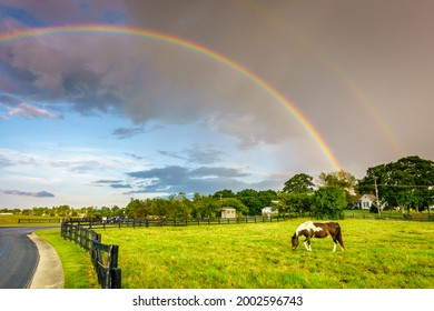 Scenic view of double rainbow over a horse pasture in Central Kentucky