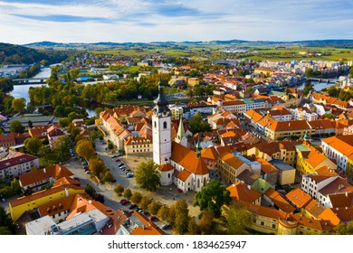 Scenic view from drone of historic center of small Czech town of Pisek on banks of Otava river with Church of Nativity of Blessed Virgin Mary on autumn day.. - Shutterstock ID 1834625947