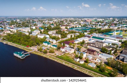 Scenic view from drone of Kostroma cityscape on bank of Volga River with complex of provincial trading arcades (Gostiny Dvor), Russia