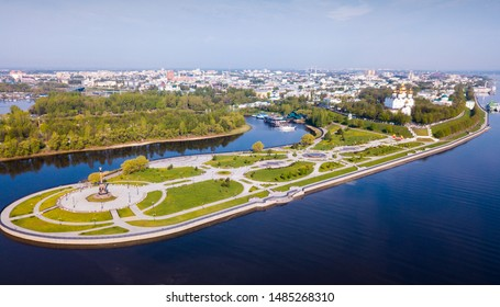 Scenic view from drone of Yaroslavl with park at Strelka in place of confluence of Kotorosl and Volga rivers and Assumption cathedral, Russia