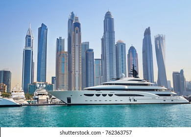 Scenic view of Dubai Marina Skyscrapers with big boat, Skyline, View from sea, United Arab Emirates
