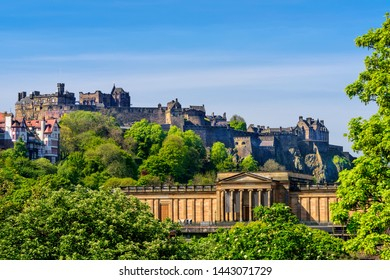 Scenic view of Edinburgh Castle, as it rests on castle rock, and the Scottish National Gallery.