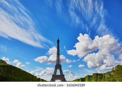 Scenic view of the Eiffel tower with blue sky and beautiful clouds