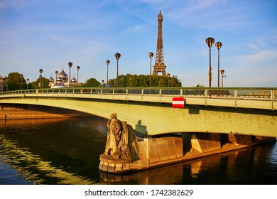 Scenic view of the Eiffel tower and Holy Trinity Cathedral and the Russian Orthodox Spiritual and Cultural Center over Alma bridge in Paris, France